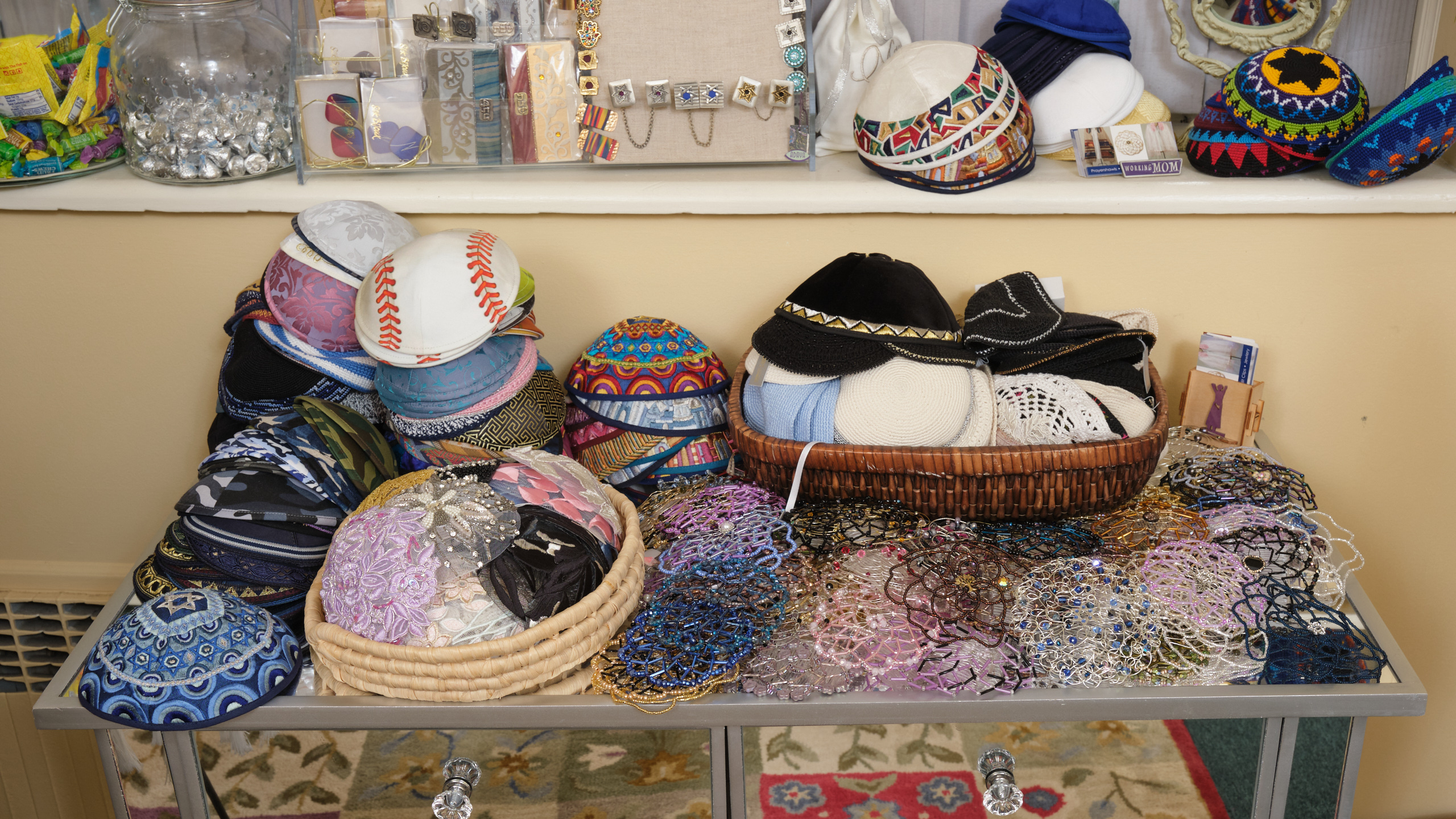 Table full of personalized kippah.